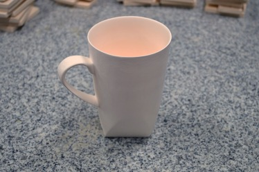 Biscuited cup read to glaze